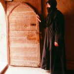 Monk in doorway of his cloister at St. Macarius Monastery.