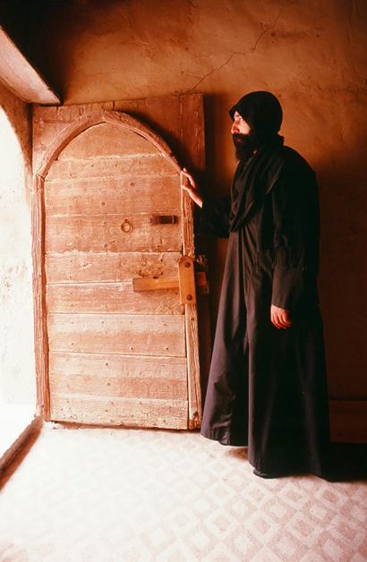 Monk in doorway of his cloister at St. Macarius Monastery.