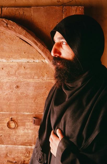 Monk in doorway of his cloister.