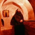 A meditative monk in a monastery chapel.
