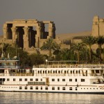Luxury Nile cruiser docked at Kom Ombu Temple