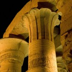 Illuminated pillars at Kom Ombu Temple