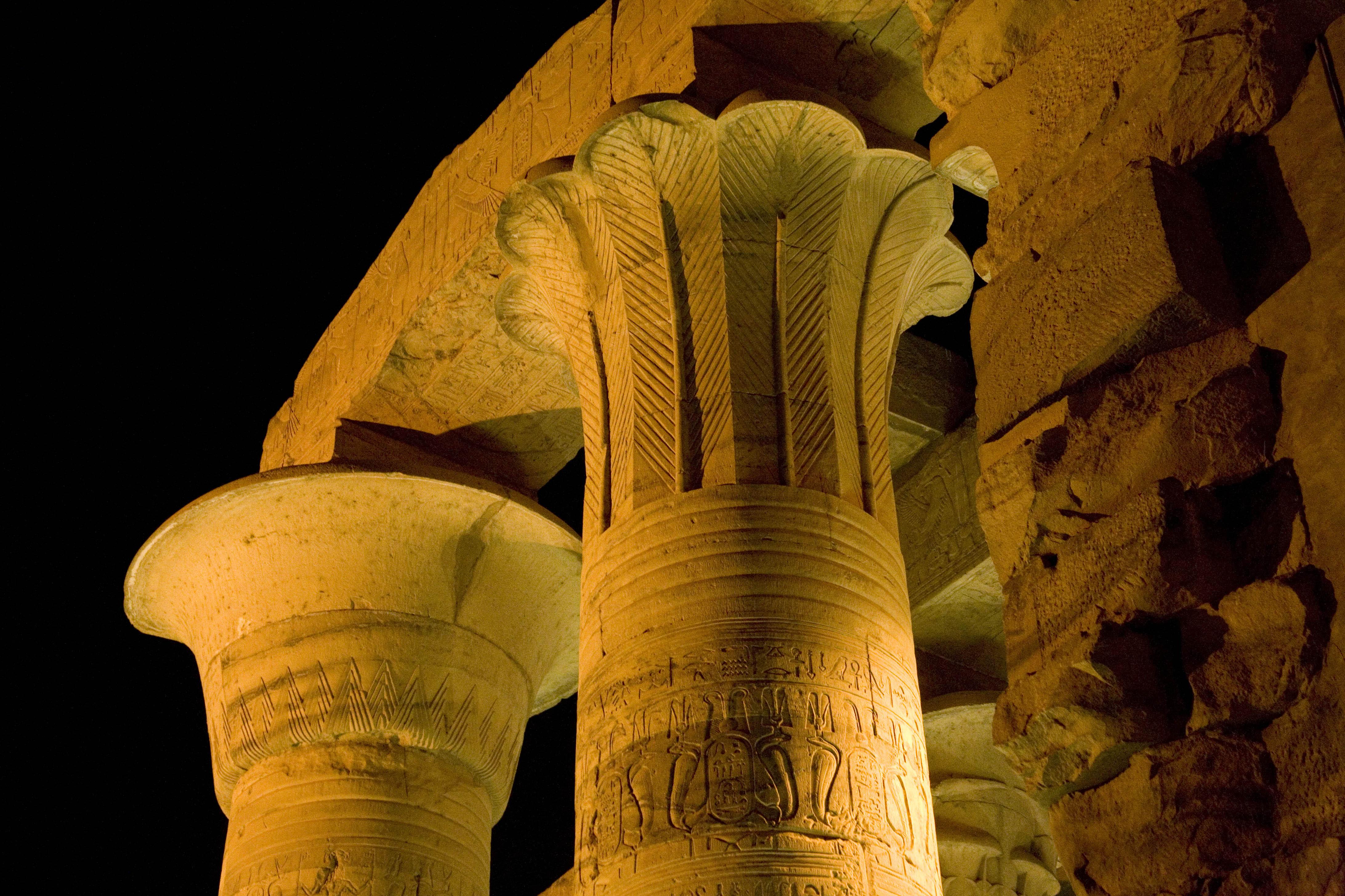 Illuminated pillars at Kom Ombu Temple