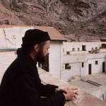 Resident monk views courtyard