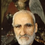 This Armenian priest stands before the image of an angel in the Vank Cathedral of the same period