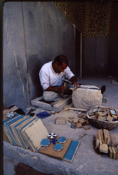 Each tile must be chipped with precision to restore the Imam Mosque to its former glory