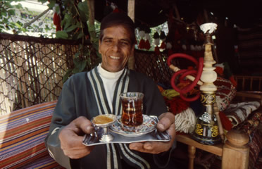 Have some tea, served from a samovar alongside frankincense and a water pipe, both heated by coal, at a traditional tea tent