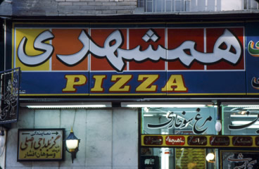 "Even downtown pizza shop signs get a modern kind of ""tile"" treatment and stylized calligraphy"