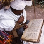 Priest reading Scripture