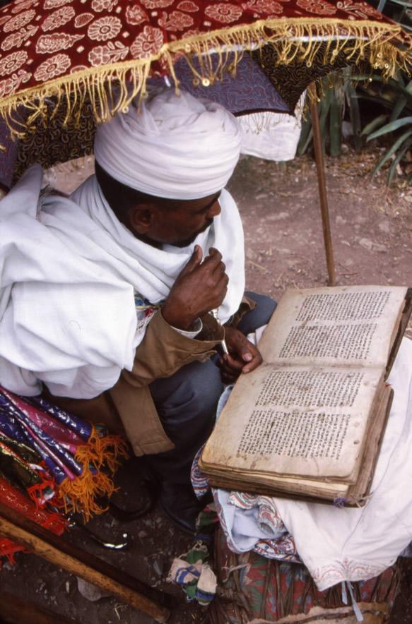 Priest reading Scripture