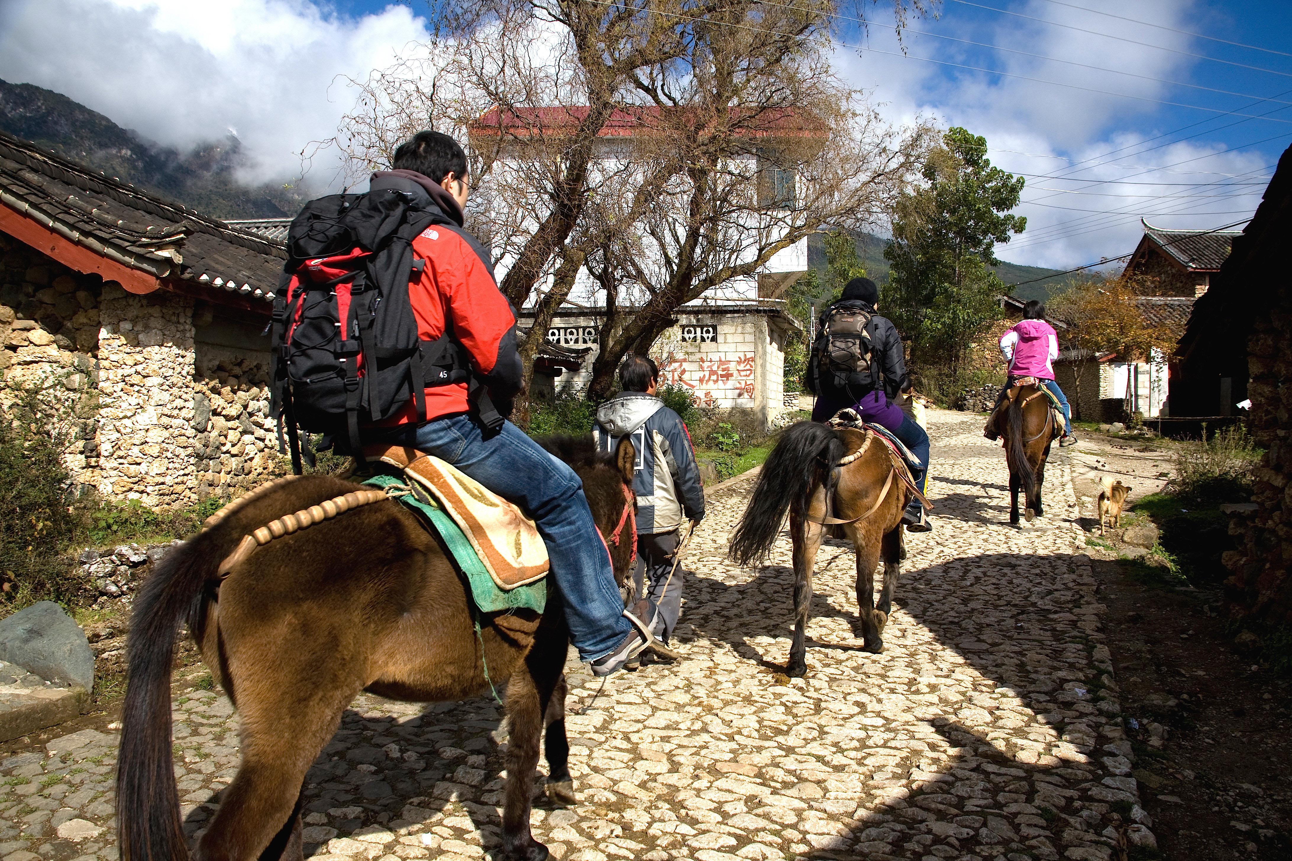 Travelers on horseback to countryside