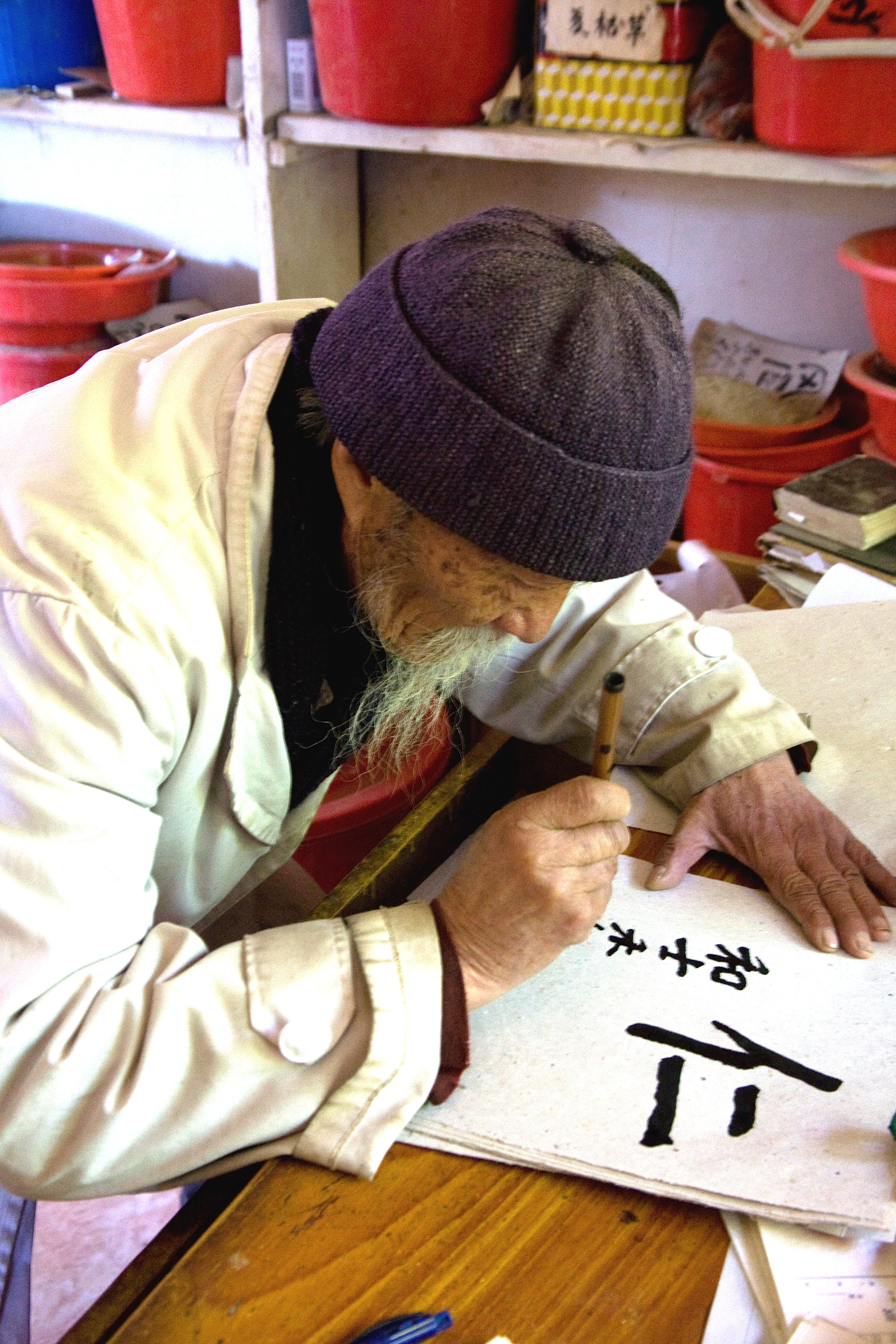 Doctor Ho writes a calligraphy prescription